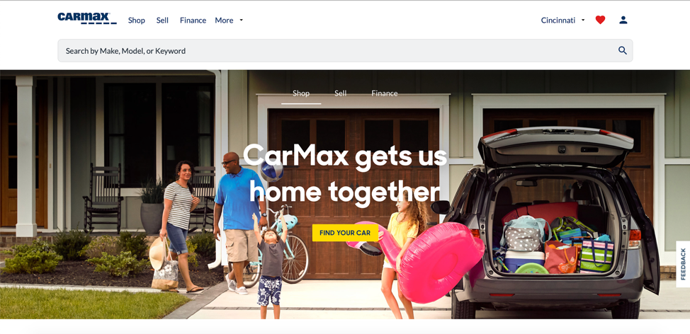 Screenshot of CarMax website, which shows customer-centric messaging and a photo of a happy family enjoying their new car.