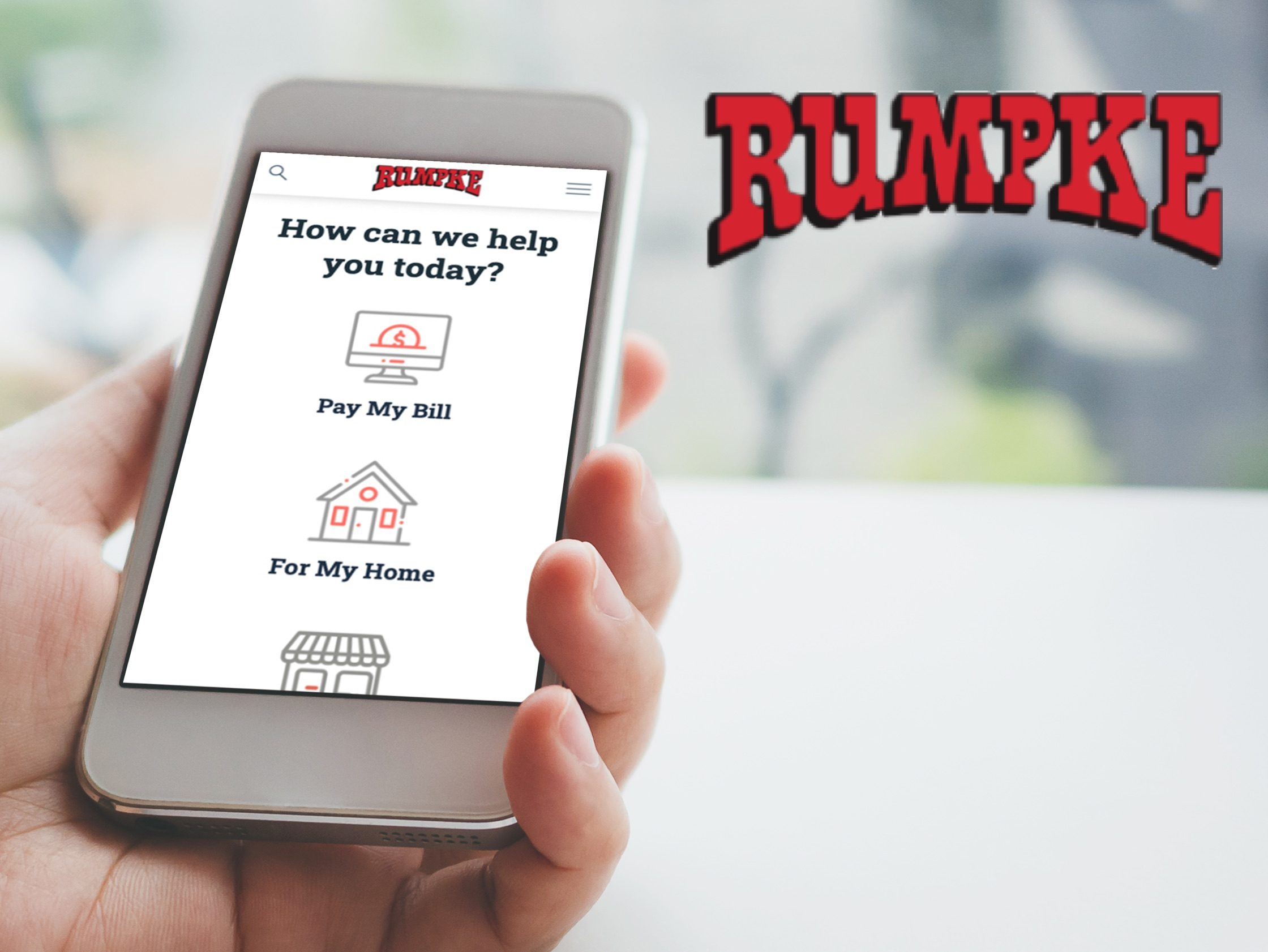 Image of person holding iPhone with Rumpke website on the screen.