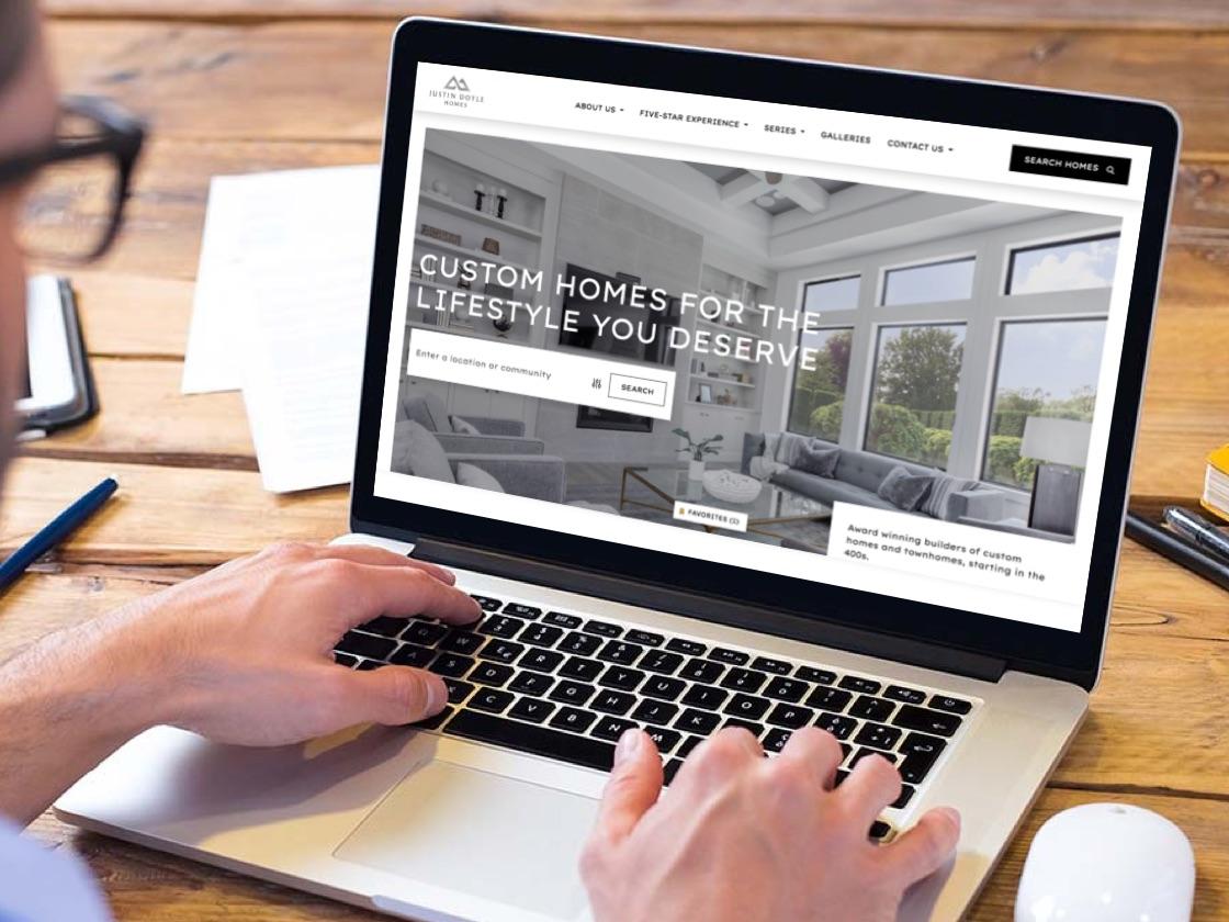 Mockup of JDH homepage on laptop