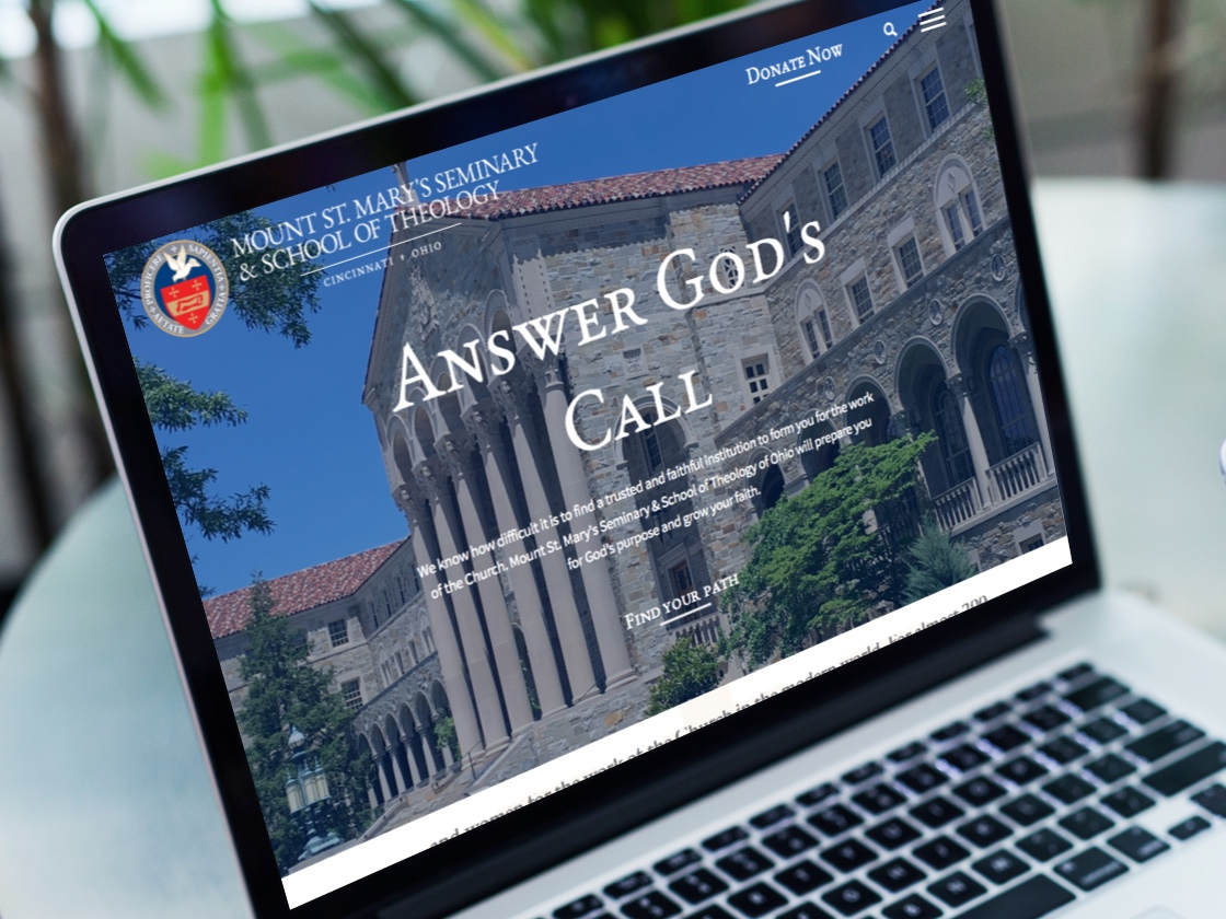 Image of Mount St. Mary's homepage on a MacBook pro laptop screen.