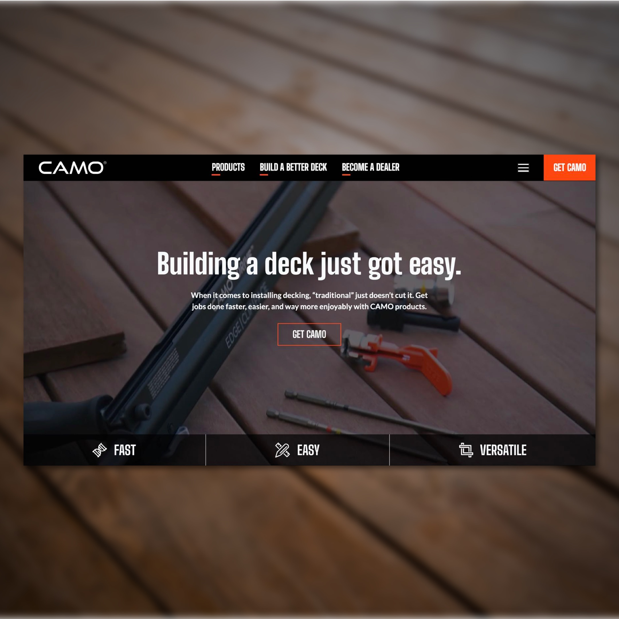 Image of CAMO homepage on top of blurry background texture of decking.