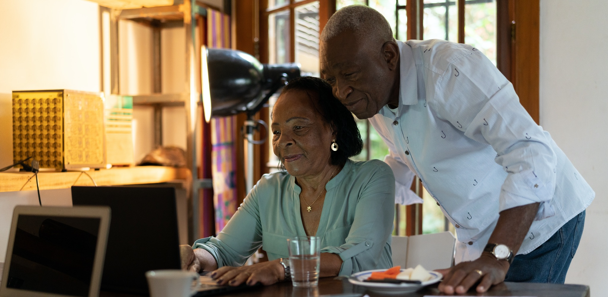 Senior African-American couple looking at computer.
